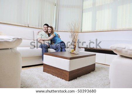 happy young couple relax at home in modern and bright living room