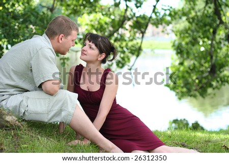 happy young couple relaxing near the river
