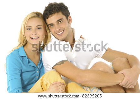 Happy young couple .sitting floor Isolated - stock photo