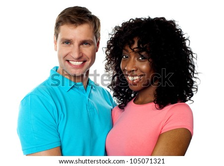 Happy young couple smiling in front of camera