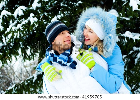 happy young couple spending time outdoor in winter park - stock photo