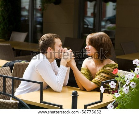 Happy young couple spending time together outdoors - stock photo
