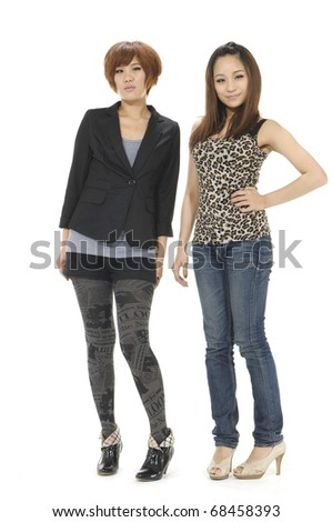 Happy young couple standing on full length over white - stock photo