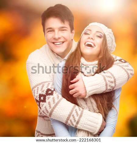 happy young couple standing over autumn background - stock photo