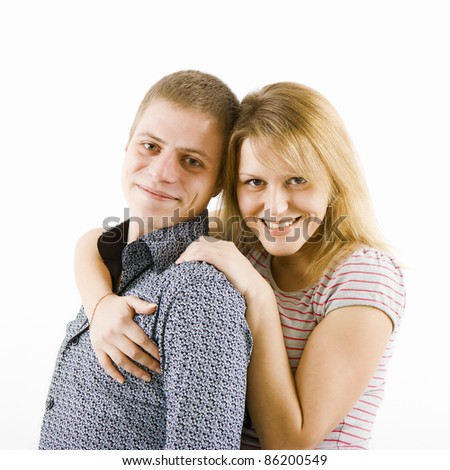 happy young couple. The girl hugs a guy. white background