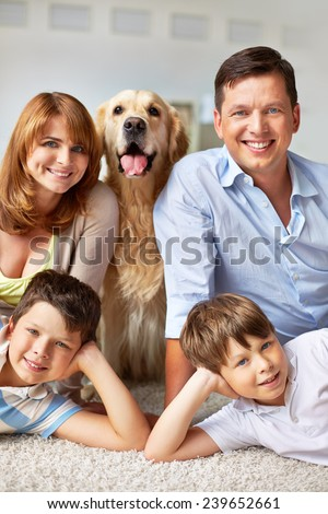 Happy young couple, their sons and fluffy pet