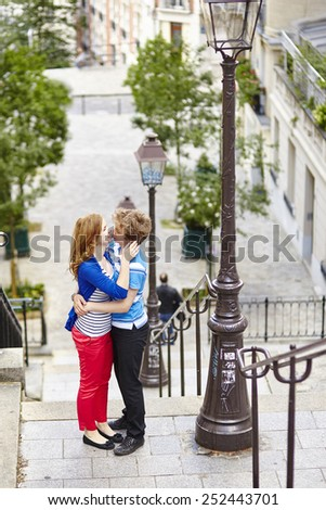 Happy young couple together in Paris, on Montmartre - stock photo