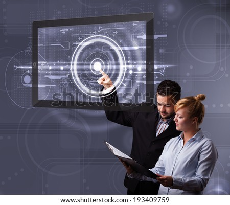 Happy young couple touching modern technology tablet - stock photo