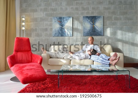 happy young  Couple Using Digital Tablet computer At Home - stock photo