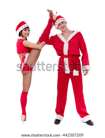 Happy young couple wearing santa claus clothes - stock photo
