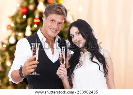 Happy Young couple with champagne glasses