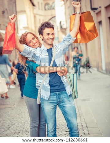 Happy Young Couple with Shopping Bags - stock photo