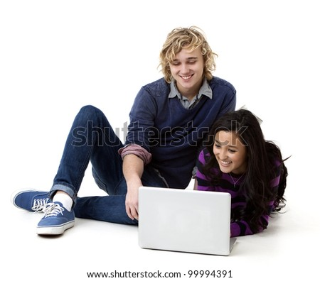 happy young couple working on a laptop