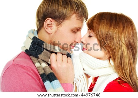 happy young couple, young man and woman wearing warm winter clothes - stock photo