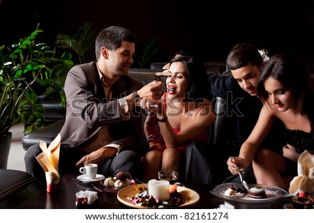happy young couples eating deserts coffee - stock photo