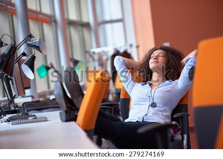happy young curly  business woman in the modern office - stock photo