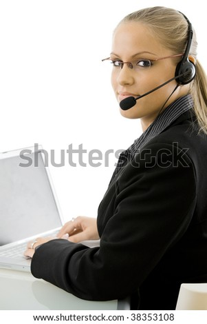 Happy young customer service operator girl wearing headset, working on laptop computer, smiling, isolated on white background.