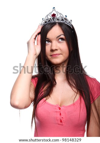 Happy young cute woman in crown on her head - stock photo