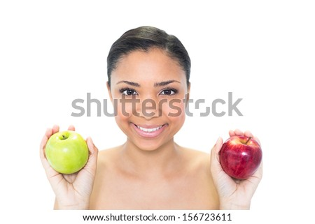 Happy young dark haired model holding apples on white background