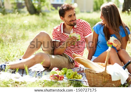 Happy young dates having picnic in the country - stock photo