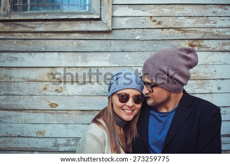 Happy young dates on background of old building - stock photo