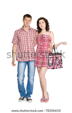 Happy young embracing couple standing on full length. - stock photo
