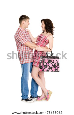 Happy young embracing couple standing on full length. Isolated on white.