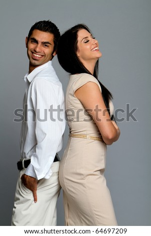 Happy young ethnic couple laughing together