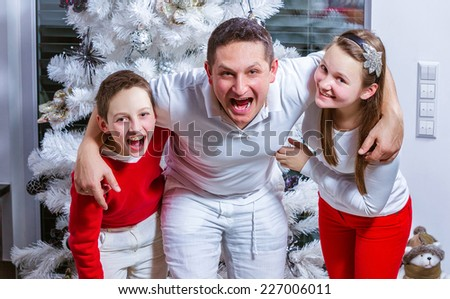 Happy young family at the Christmas tree