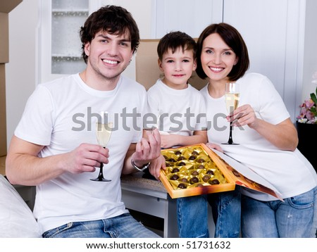 Happy young family celebrating new home together - indoors