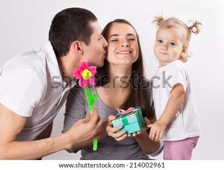 Happy young family congratulate mom