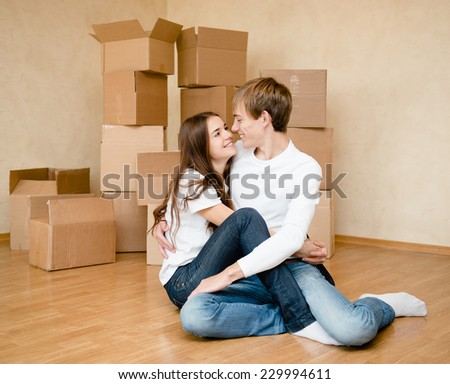 happy young family embracing on a background of cardboard