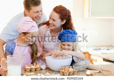 Happy young family enjoys baking together - stock photo