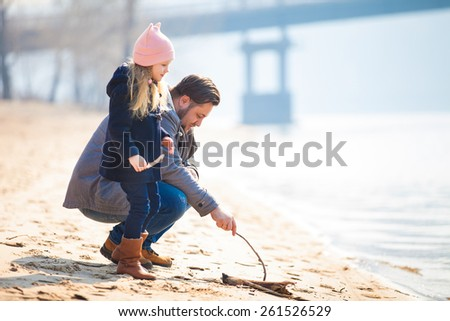 happy young family have fun on beach. Father and daughter - stock photo