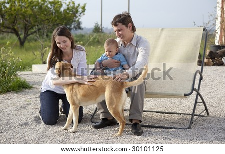 happy young family having fun in garden - stock photo