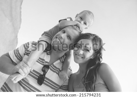 Happy young family having fun outdoors in summer. Black and white photo  - stock photo