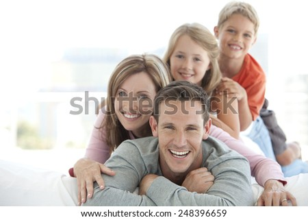 Happy young family making a human pyramid