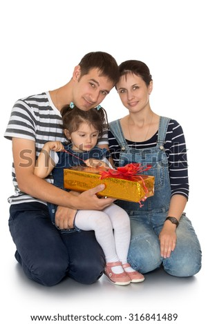 Happy Young family-mom, dad, and a beautiful little girl who is sitting on dad's lap considering a gift. About family Christmas mood-Isolated on white background - stock photo