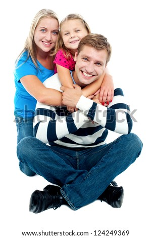 Happy young family; mother, father and their daughter isolated against white background