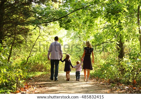happy young family on the nature