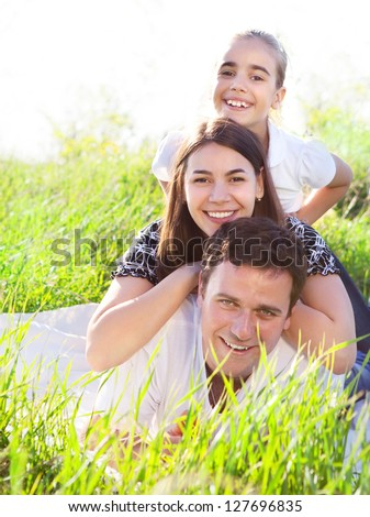 Happy young family outdoors in spring day