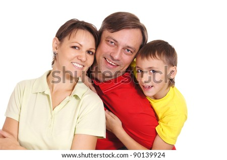 happy young family posing on a white