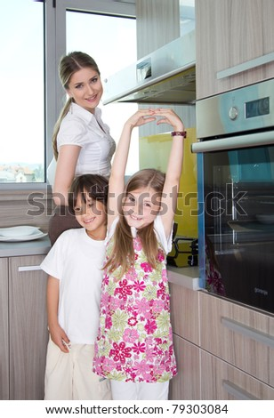 happy young family preparing lunchin the kitchen