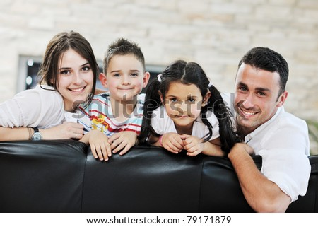 happy young family relax and have fun at modern home indooor - stock photo