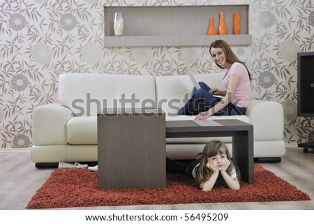 happy young family relaxing in modern livingroom at home