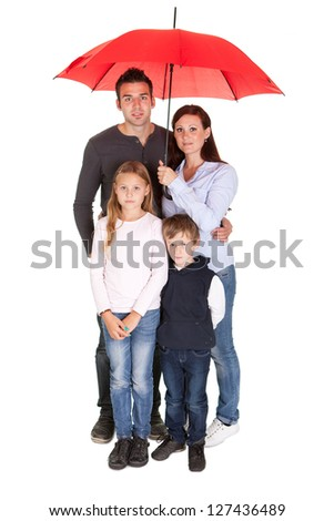 Happy young family using umbrella. Isolated on white