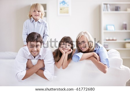 Happy young family with children at home - stock photo