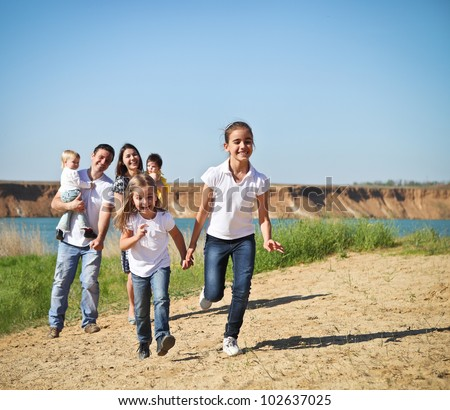 Happy young family with children outdoor - stock photo