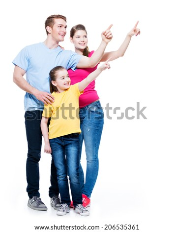 Happy young family with kid pointing finger up -  isolated on white background - stock photo