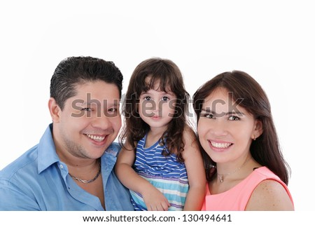 Happy young family with little girl posing on white background - stock photo
